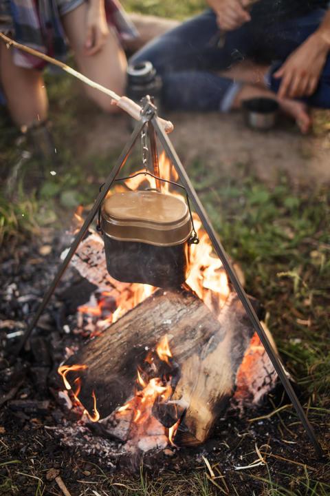 campfire with metal pot. closeup photo Photo