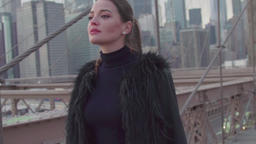 slow motion beautiful girl walking along the famous Brooklyn bridge GIF
