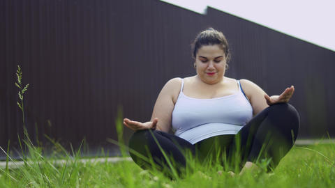 The fat girl is doing exercises Live Action