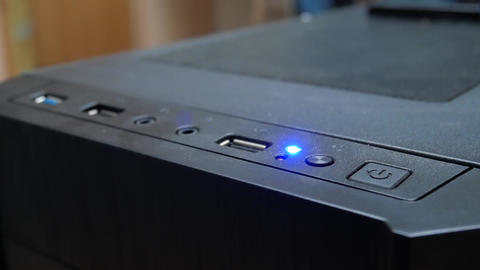 Finger is pushing power button to PC computer Footage