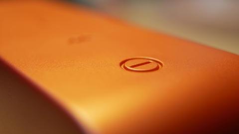 Power On Button On Wireless Bluetooth Portable Orange Audio System Footage