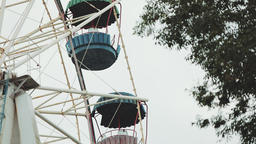 Ferris wheel. Ferris wheel in an amusement park on a background of Cloudy sky GIF