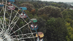 Ferris wheel in an amusement park on a background of Cloudy sky GIF