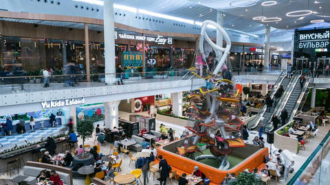 timelapse entertainment center with stores playgrounds and food court Live Action