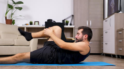 Fit young man stretches for yoga Footage