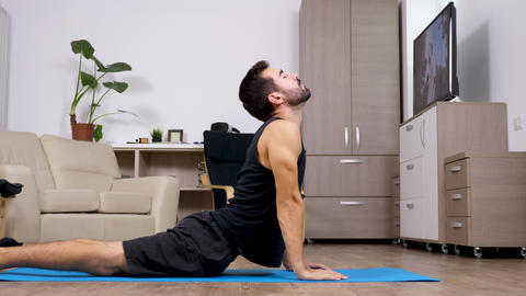 Fit man does different yoga poses Footage