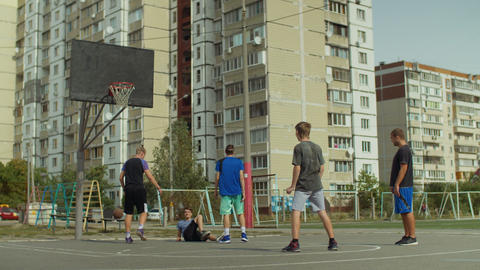 Defender committing a foul during streetball game Live Action