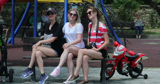 Three Young Pretty Women Sitting On A Public Bench Footage