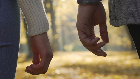 Close-up of boyfriend and girlfriend clasping each other hands in slow-motion Live Action