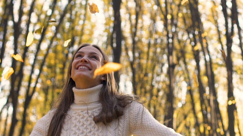 Charming smiling woman jumps in beautiful forest, solving all problems, triumph Footage