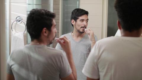 Happy Gay Couple Brushing Teeth In Bathroom Footage