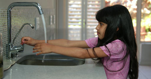 Little girl washing her hands Footage
