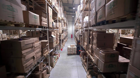 Camera Cranes Up on Shelves of Cardboard Boxes Inside a Storage Warehouse Footage