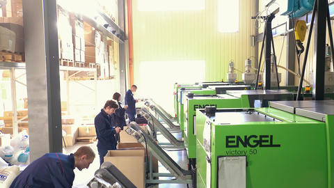 Workers Operate Equipment Manufacture of Plastic Parts Footage