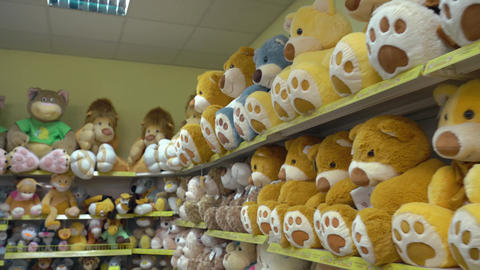 Soft Toys Are On Counter In Store: Bears Yellow stock footage