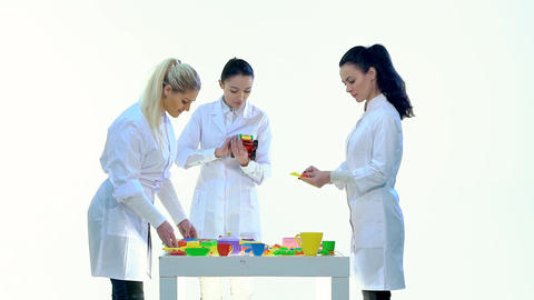 Laboratory Workers Check Quality of Plastic Toys in White Room Footage