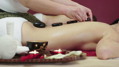 Beautiful Young Brunette Girl Having Stone Massage Footage
