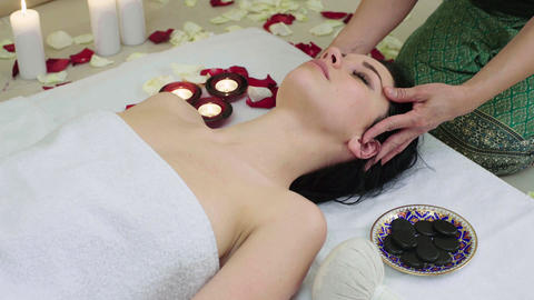 Beautiful Woman Receiving Face Massage in Spa Footage