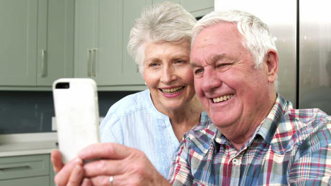Smiling old people taking a selfie Live Action