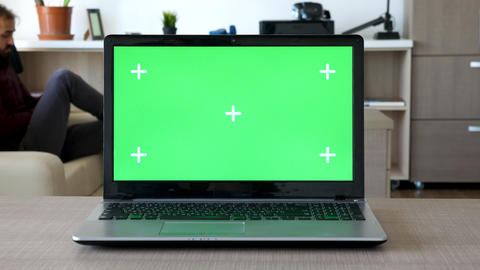 Zoom in shot on a computer screen with chroma mock up Live Action