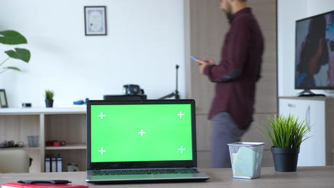 Laptop with isolateg mock up green screen chroma in modern flat Footage