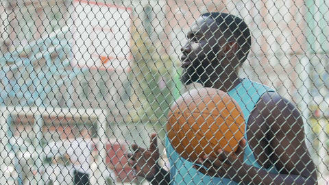 Basketball coach eagerly waiting for team at sports ground, outdoor training Live Action