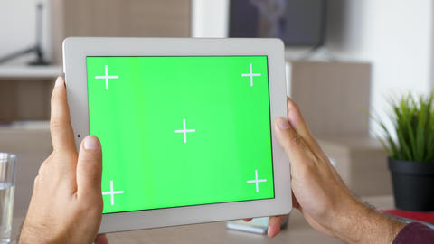 Holding a digital tablet PC in hands in horizontal mode Footage