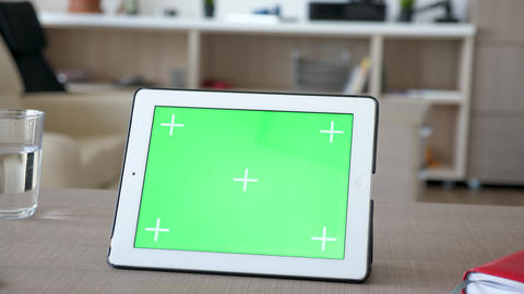 Digital tablet PC with green screen chroma mock-up on a table Footage