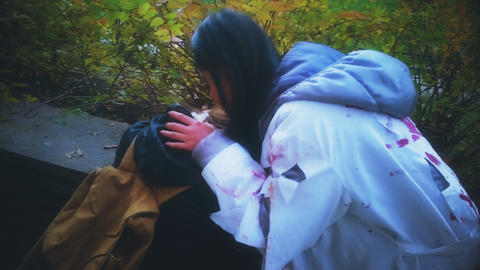 Crazy Asian woman drinking blood from unfortunate victim, Halloween zombie Live Action