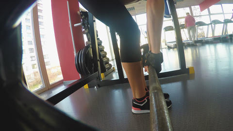 Slim muscular girl doing deadlift in gym pumping muscles, endurance and strength Live Action