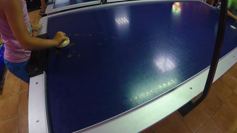 Children playing air hockey game at amusement park, scoring goals, childhood Live Action