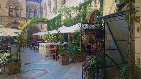 Cozy cafe terrace with flower pots and umbrellas, venue for wedding ceremony Footage