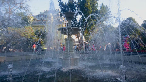 Amazing fountain splashing in summer city garden, family weekend, sightseeing Live Action