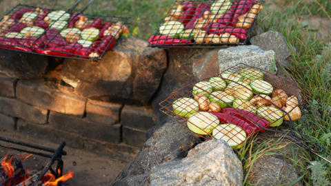 Vegetarian barbecue. Vegetables and a fire in the country Live Action