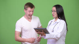 Young Asian woman doctor giving consultation to young man patient Footage