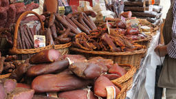 Farmers market. Traditional meats and sausages for sale Live Action