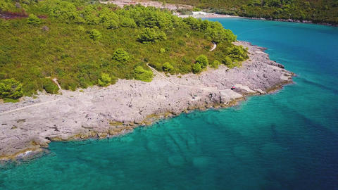 Little beach among rocks and clear turquoise waters of Adriatic sea. Aerial view Live Action