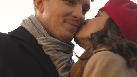 Tender kiss on a cheek, happy male in love with his date, care and appreciation Live Action