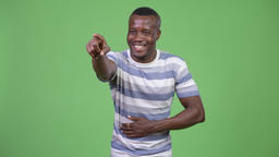 Young happy African man laughing and pointing finger Footage
