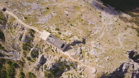 Aerial shot of mausoleum on the top of Lovchen mountain at sunny day, Montenegro 영상물