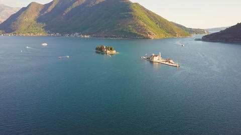 Islands with medieval churches at the Kotor Bay between Montenegro mountains Footage