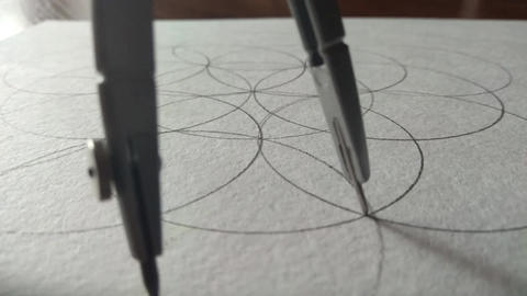 compasses draw a circle on a piece of paper GIF