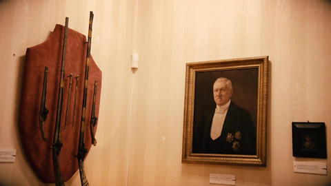 Old paintings and Trophy Rifles on a wall in an old house from the 20th century Footage
