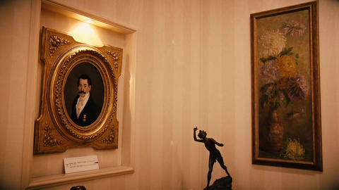 Old paintings on a wall in an old house from the 20th century Footage
