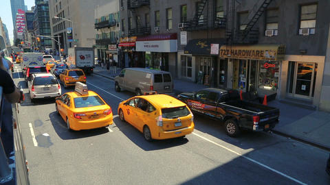 Yellow taxicab in the streeets of New York City Live Action