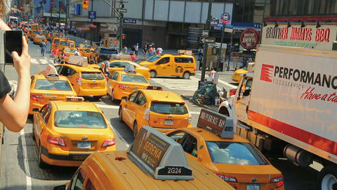 Row of yellow New York City taxi cabs Live Action