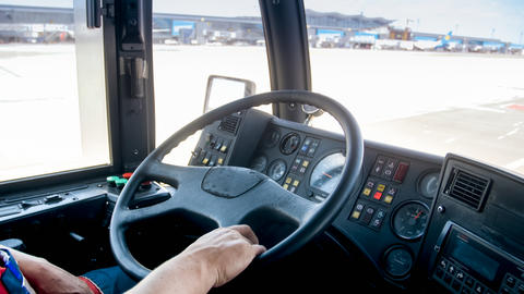 Closeup photo of bus steering wheel working in airport フォト