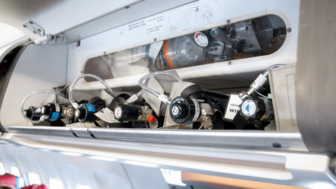 Closeup image of emergency safety system wuth valves and tubes on modern jet フォト