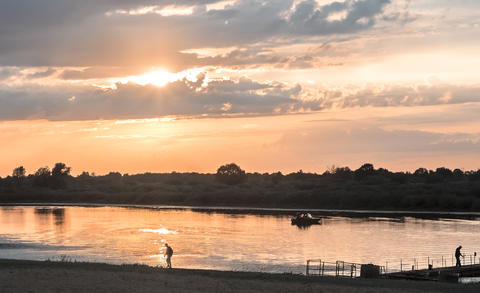 Evening landscape: sunset over a small river フォト