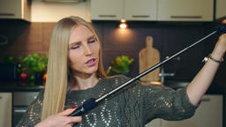 Young vlogger talking about selfie stick. Attractive young woman talking about Footage